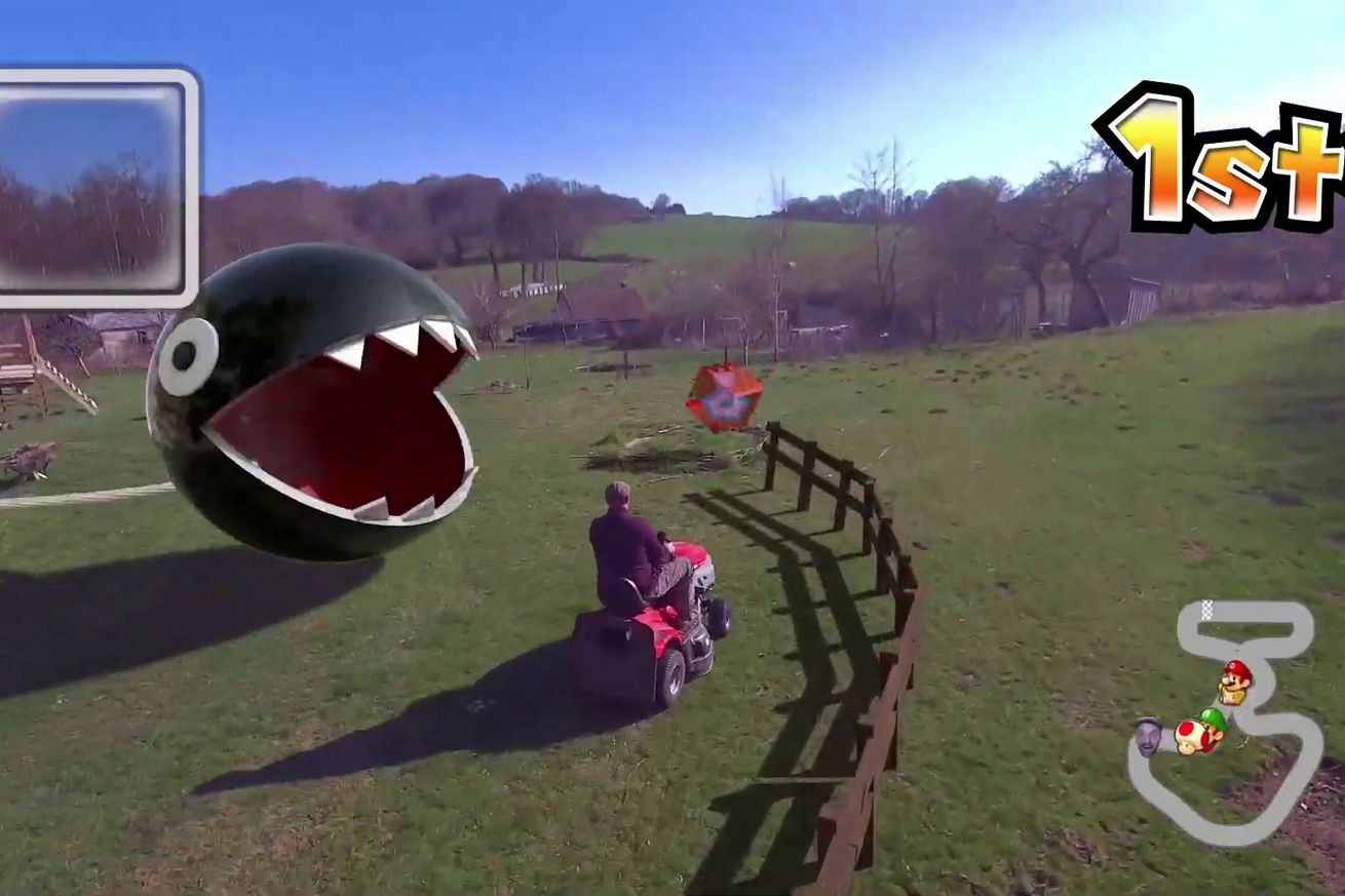 a chain chomp appears to be attacking this riding lawnmower.