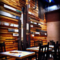 The taqueria's cafe has seating for 52 with another 10 seats at the bar. Wooden panels are lined with Mexican newspapers in a papier mache effect.