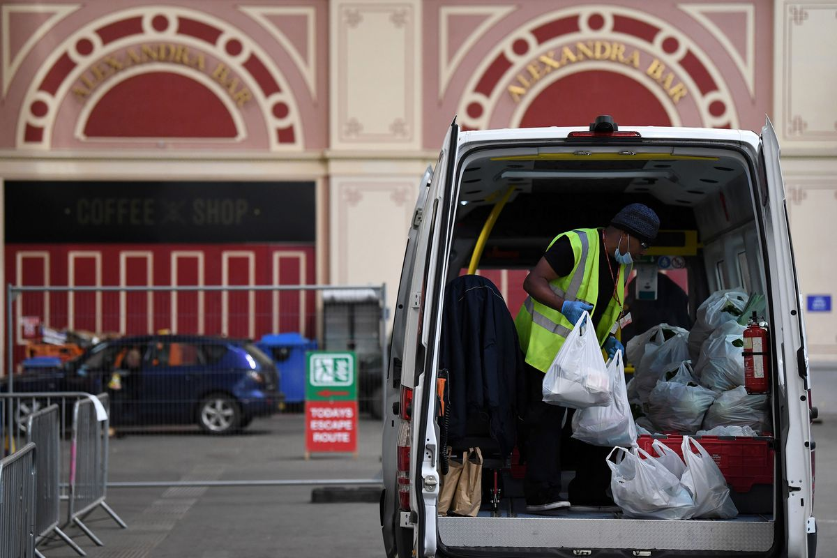 A man loads a delivery van at a London food bank, which are experiencing huge demand under coronavirus lockdown