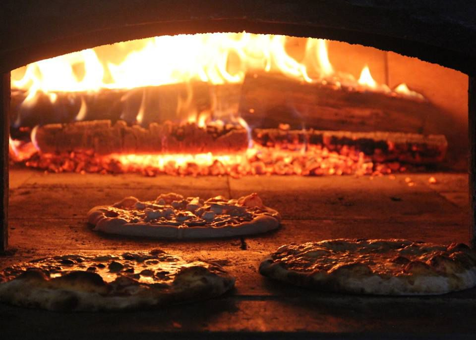 Pizzas in the oven at Rock Harbor Grill, big sibling to the forthcoming Grill 43