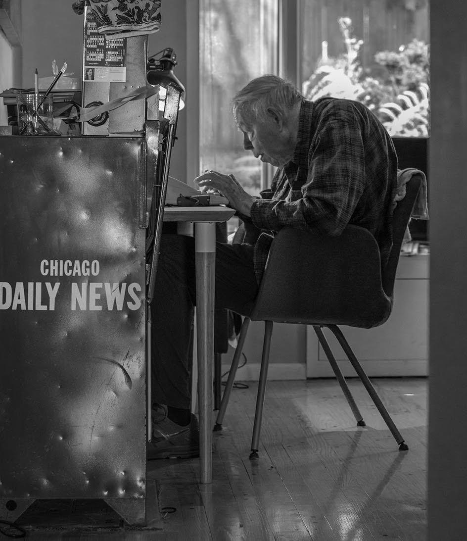 Robert J. Herguthtypes next to a dented Chicago Daily News dispenser. Provided photo
