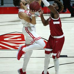 Utah Utes forward Timmy Allen (1) drives on Stanford Cardinal guard Daejon Davis (1) in Salt Lake City on Thursday, Jan. 14, 2021.