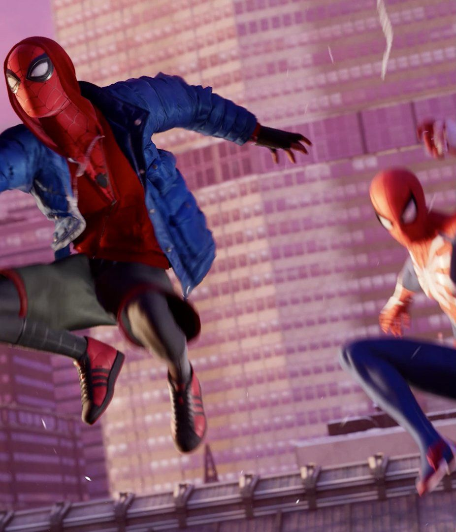 Miles Morales as Spider-Man, wearing red and black Adidas high-top shoes, swinging through New York City with Peter Parker's Spider-Man behind him in Spider-Man: Miles Morales