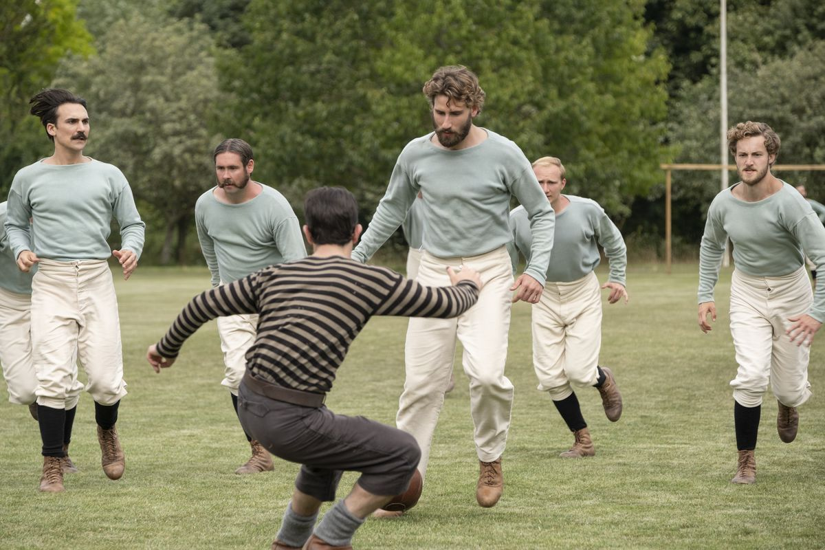 """Kevin Guthrie (foreground center) and Edward Holcroft (background center) in a scene from """"The British Game,"""" a six-part drama charting the origins of soccer."""