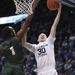 Brigham Young Cougars guard TJ Haws (30) drives on San Francisco Dons guard Jamaree Bouyea (1) in Provo on Saturday, Feb. 8, 2020.