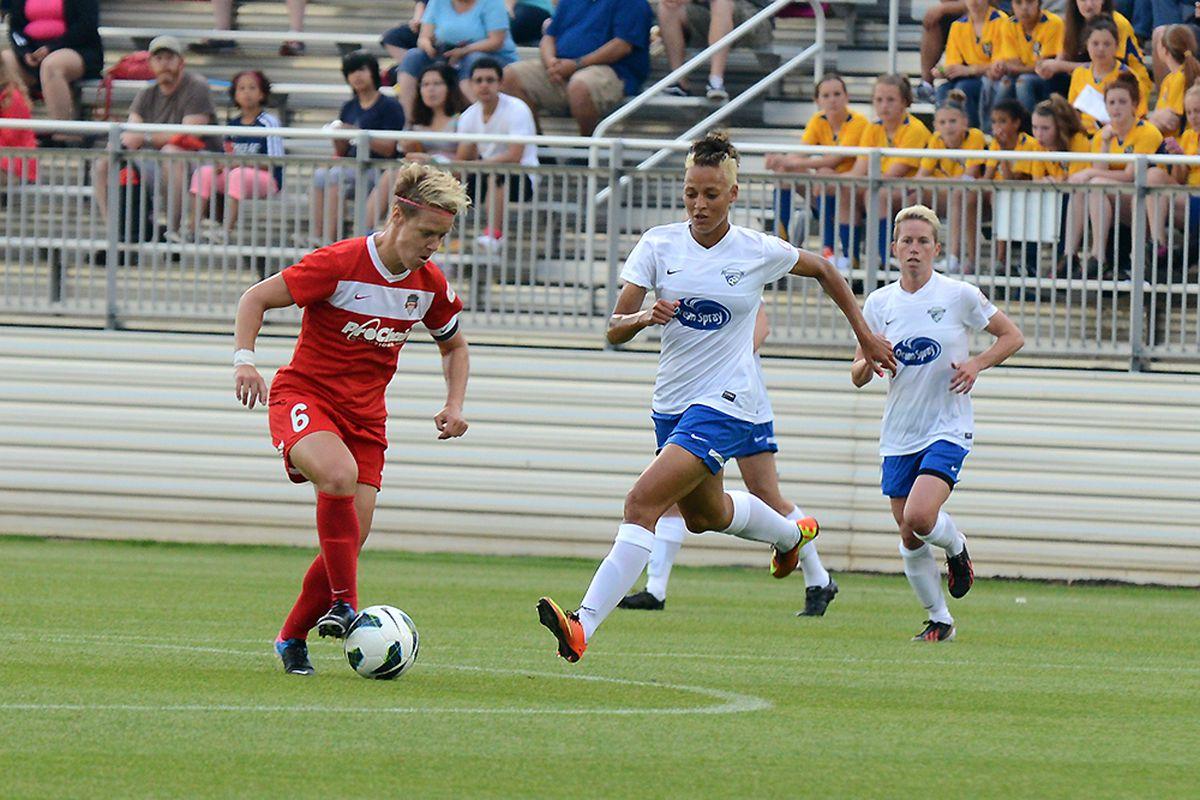 Washington Spirit midfielder Lori Lindsey, pursued by Boston's Lianne Sanderson and Joanna Lohman