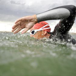 John Karren swims in a Herriman lake as part of his training. He typically is one of the fastest swimmers in triathlons.