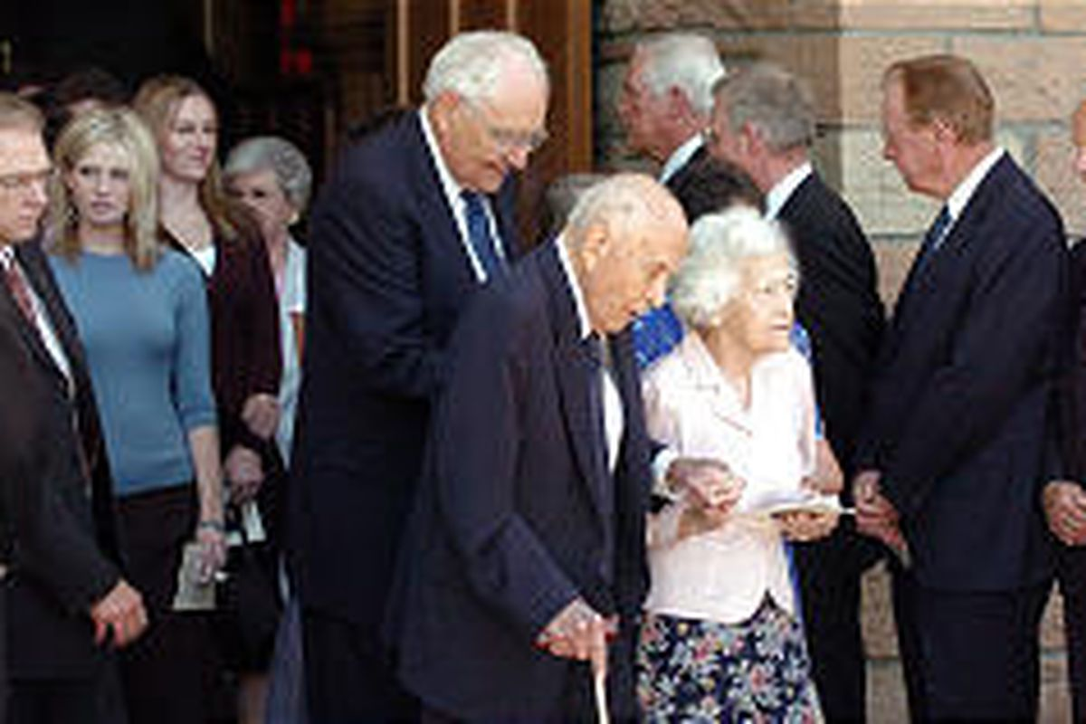 Elder David B. Haight and Sister Ruby Haight, followed by Elder L. Tom Perry, exit the Tabernacle after the funeral for Elder Neal A. Maxwell.