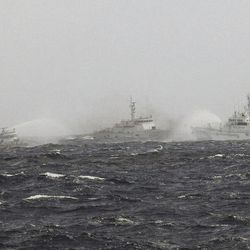 In this photo released by Taiwan's Central News Agency, Japan Coast Guard patrol boats spray their water cannons towards a Taiwan Coast Guard patrol boat and Taiwanese fishing boats near the disputed islands called Senkaku in Japan and Diaoyu in China, in the East China Sea, Tuesday, Sept. 25, 2012. On Tuesday morning, about 50 Taiwanese fishing boats accompanied by 10 Taiwanese surveillance ships came within almost 20 kilometers (about 12 miles) of the disputed islands - within what Japan considers to be its territorial waters.