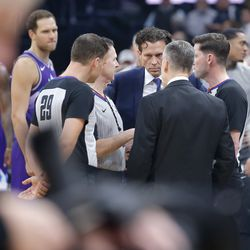 Utah Jazz coach Quin Snyder meets with Oklahoma City coach Billy Donovan and officials before before an NBA basketball game was postponed in Oklahoma City, Wednesday, March 11, 2020.