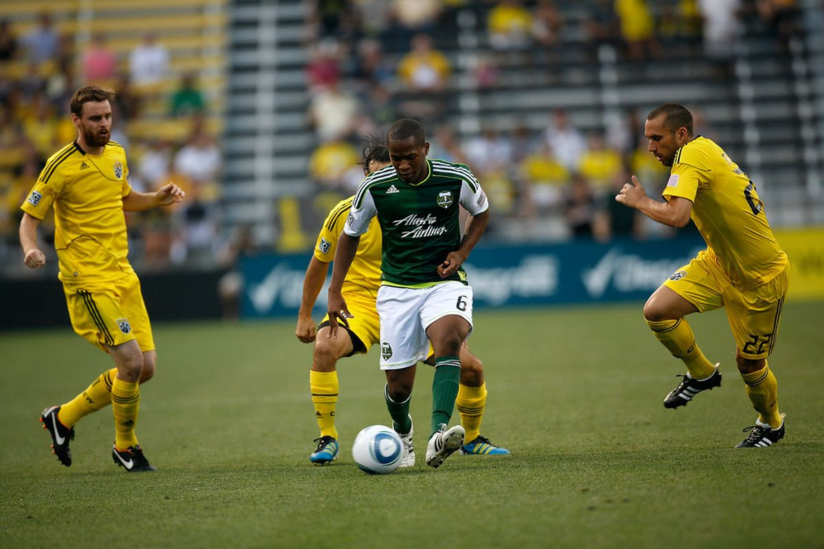 COLUMBUS, OH - JULY 23:  Darlington Nagbe #6 of the Portland Timbers is chased by Dejan Rusmir #22 of the Columbus Crew during the first half on July 23, 2011 at Crew Stadium in Columbus, Ohio.  (Photo by Kirk Irwin/Getty Images)