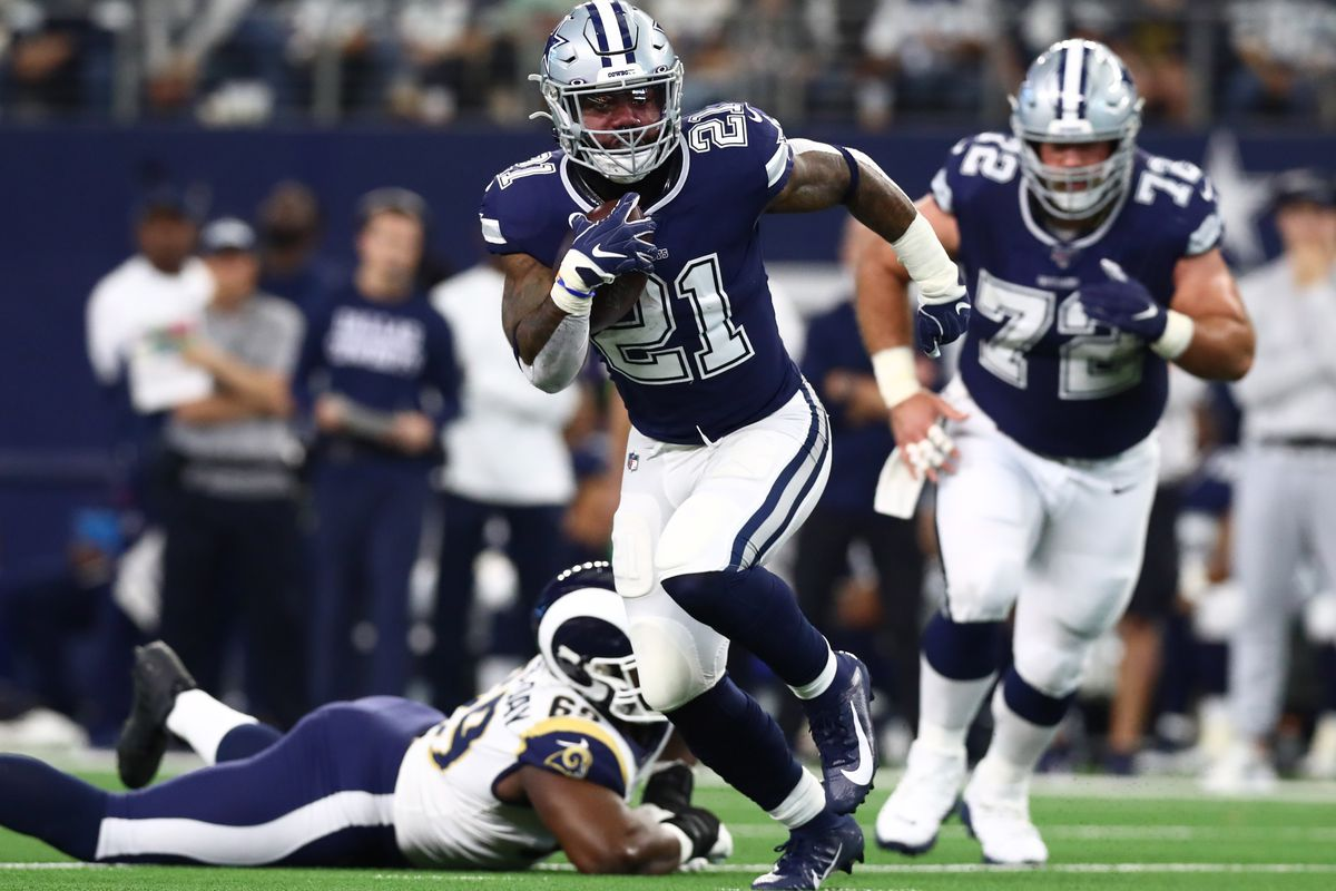 Dallas Cowboys running back Ezekiel Elliott runs with the ball in the first quarter against the Los Angeles Rams at AT&T Stadium.