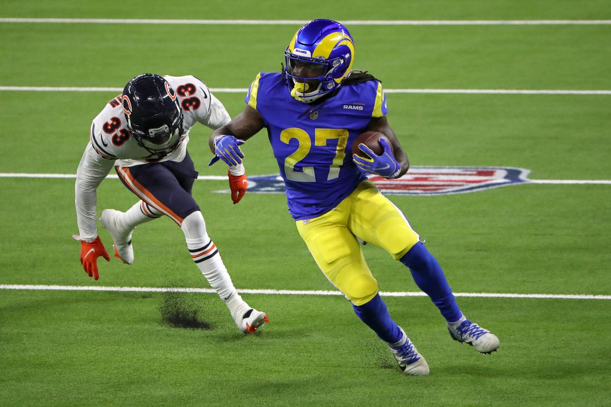 Darrell Henderson #27 of the Los Angeles Rams runs with the ball against Jaylon Johnson #33 of the Chicago Bears at SoFi Stadium on October 26, 2020 in Inglewood, California.