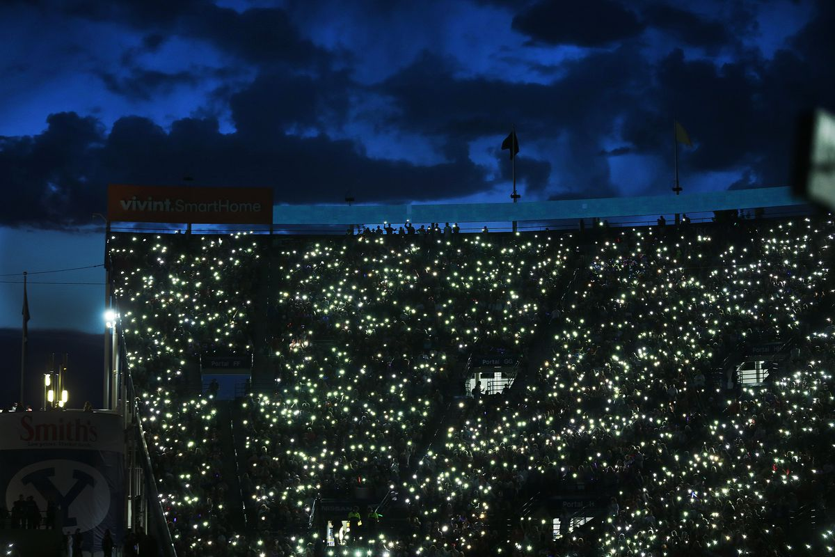 Attendees light up their cellphones during Stadium of Fire at LaVell Edwards Stadium in Provo on Thursday, July 4, 2019.