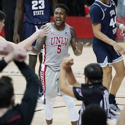 UNLV's David Jenkins Jr. (5) celebrates after a play against Utah State during game Monday, Jan. 25, 2021, in Las Vegas.