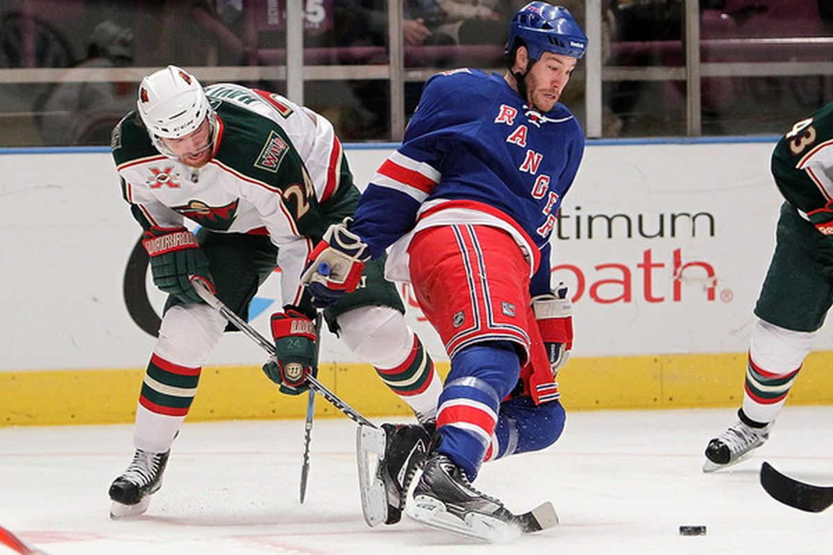 NEW YORK, NY - MARCH 03:  Martin Halvat #24 of the Minnesota Wild knocks down Brandon Prust #8 of the New York Rangers at Madison Square Garden on March 3, 2011 in New York City.  (Photo by Nick Laham/Getty Images)