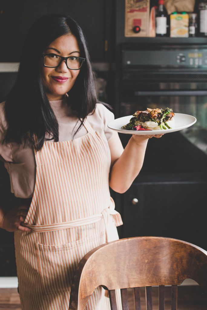 Kristina Glinoga holds up a plate of food