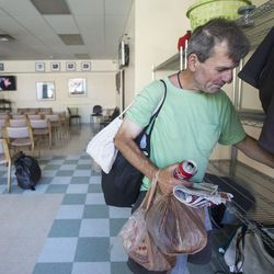 A homeless man gathers his belongings at the end of the day at the Weigand Homeless Resource Center on Thursday, June 29, 2017.