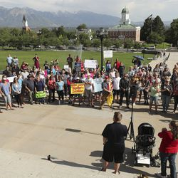 Demonstrators rally against the possibility of increased coronavirus restrictions outside of the Capitol in Salt Lake City on Thursday, June 25, 2020.