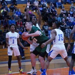 Lane's Vuk Djuric (33) powers his way for two points against Proviso East, Wednesday 02-27-19. Worsom Robinson/For Sun-Times