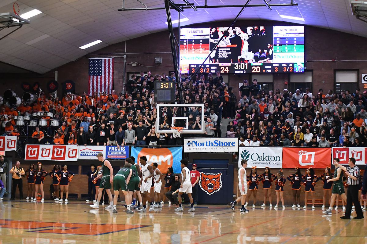 Evanston's gym packed for a game against New Trier in 2019. The Wildkits' gym already has a shot clock installed.
