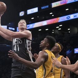 Brooklyn Nets center Justin Hamilton (41) goes to the basket past Indiana Pacers forward Rakeem Christmas (25) during the second half of an NBA basketball game, Friday, Oct. 28, 2016, in New York. The Nets won 103-94. (AP Photo/Mary Altaffer)