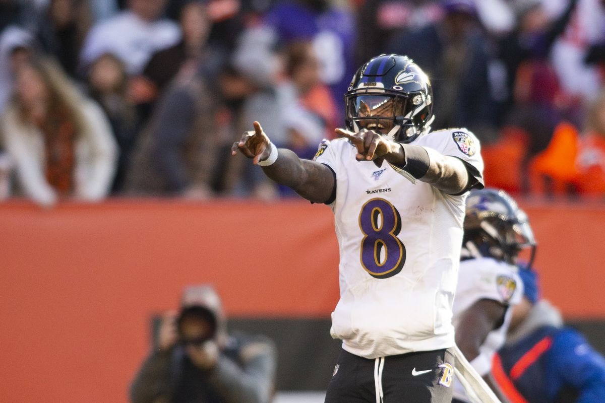 Baltimore Ravens quarterback Lamar Jackson celebrates the team's touchdown against the Cleveland Browns during the second quarter at FirstEnergy Stadium.