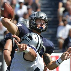 Old Dominion quaterback Taylor Heinicke throws a pass against New Hampshire during an NCAA college football game Saturday, Sept. 22, 2012, in Norfolk, Va. Old Dominion won 64-61.  Heinicke set new school records for completions (55), attempts (79), and passing yards (730) in the game.