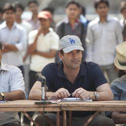 "Vivek (Darshan Jariwala, left), J.B.s Indian liaison, and JB (Jon Hamm) clock potential pitchers in India as Ray (Alan Arkin) sleeps in ""Million Dollar Arm."""