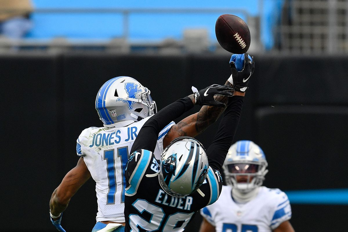 Marvin Jones #11 of the Detroit Lions fails to pull in this fourth down reception as he is defended by Corn Elder #29 of the Carolina Panthers during the second half at Bank of America Stadium on November 22, 2020 in Charlotte, North Carolina.