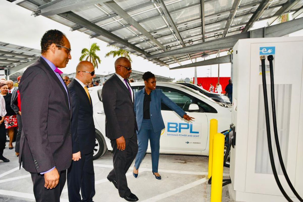 A group of politicians in suits attend to opening of a new solar carpark facility in the Bahamas.