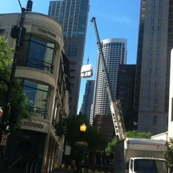 Furniture and fixtures being hoisted to the roof via a Twitpic mention from @Suitsupply on Twitter
