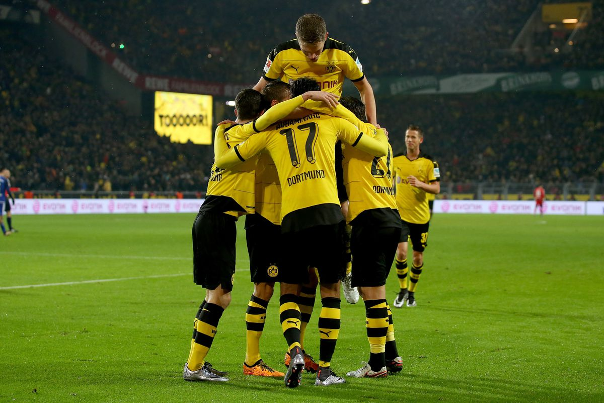 The gang celebrates Aubameyang securing the win for Dortmund