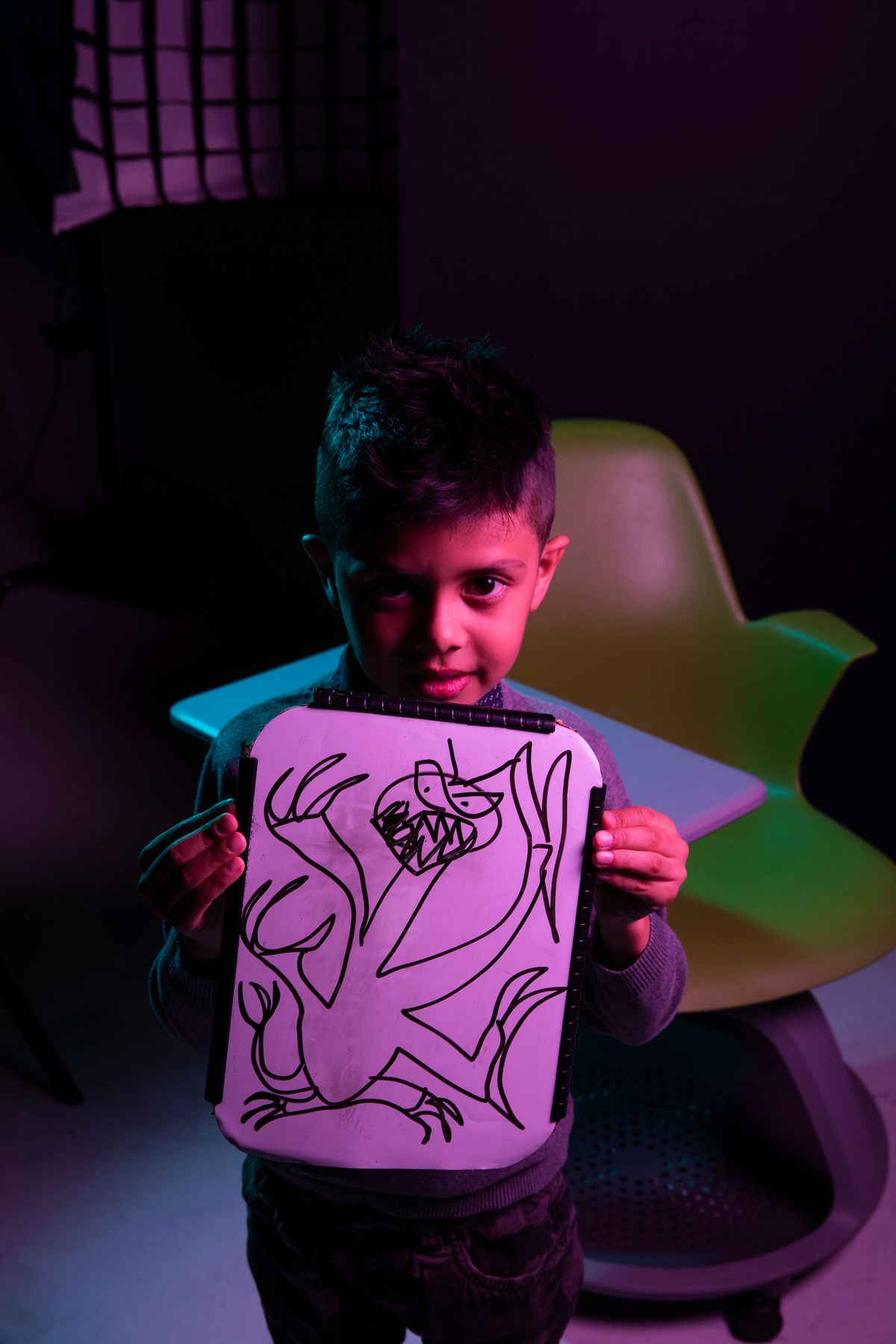 Benjamin holds a piece of his artwork at Utah Valley University in Orem on Friday, Oct. 30, 2020. Benjamin is a participant in the Super Spectrum Showcase and Soiree at the Melisa Nellesen Center for Autism at UVU.