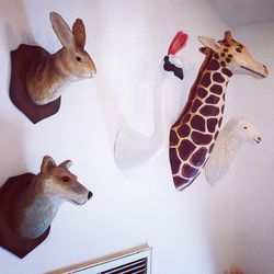 """Enchanting animal heads mounted on the wall, similar to <a href=""""http://la.racked.com/archives/2014/04/21/jenni_kayne_shares_her_kids_incredible_rooms_with_the_glow.php""""target=""""blank"""">Jenni Kayne</a>'s kids playroom setup. (Side note: how are Gwyneth and"""