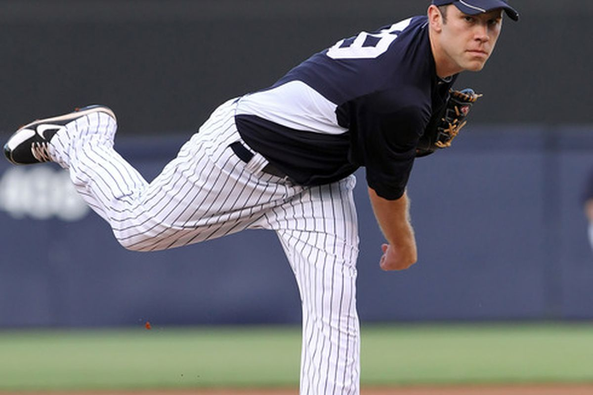 March 29, 2012; Tampa, FL, USA; New York Yankees starting pitcher David Phelps (79) throws a pitch in the first inning against the Baltimore Orioles at George M. Steinbrenner Field. Mandatory Credit: Kim Klement-US PRESSWIRE