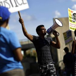 Rodney Kennedy, center, leads demonstrators during a protest the day after a jury found George Zimmerman not guilty in the Florida shooting death of teenager Trayvon Martin, Sunday, July 14, 2013, in Baltimore. (AP Photo/Patrick Semansky)