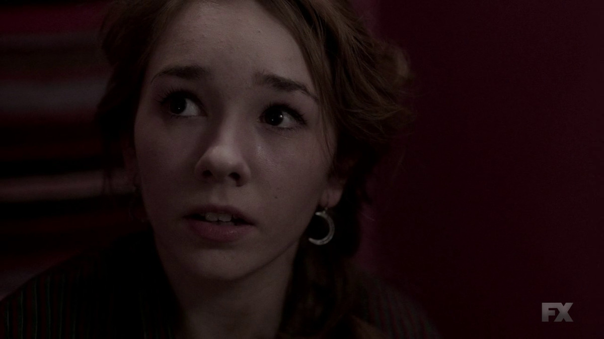 Paige (Holly Taylor) can't tell her pastor the truth about her parents on The Americans.