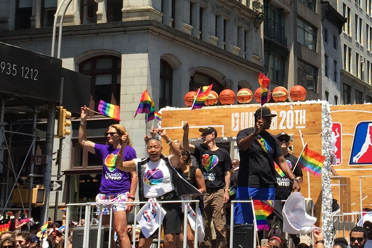 NEW YORK CITY - JUNE 26: Legends Sue Wicks, WNBA President Lisa Borders, NBA Commissioner Adam Silver and Jason Collins takes in the sights during the 2016 New York City Pride Parade on June 26, 2016 in New York, New York. NOTE TO USER: User expressly acknowledges and agrees that, by downloading and or using this photograph, User is consenting to the terms and conditions of the Getty Images License Agreement. Mandatory Copyright Notice: Copyright 2016 NBAE