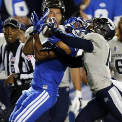 Jordan Leslie (9) of the Brigham Young University Cougars pulls in a pass with Jalen Davis (13) of the Utah State Aggies defending during NCAA football in Provo, Friday, Oct. 3, 2014.
