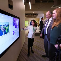 Lena Riddle, left, helps Brian and Jill Edwards with one of the green screen stations as The Church of Jesus Christ of Latter-day Saints and the Family History Library introduce a new 10,139-square-foot, interactive discovery experience in Salt Lake City on Tuesday, Feb. 7, 2017.