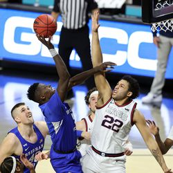 Brigham Young Cougars forward Gideon George (5) pushes up a shot over Gonzaga Bulldogs forward Anton Watson (22) as BYU and Gonzaga play in the finals of the West Coast Conference tournament at the Orleans Arena in Las Vegas on Tuesday, March 9, 2021.
