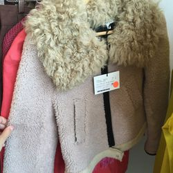 Pink shearling Hache coat, $700 (was $2,245)
