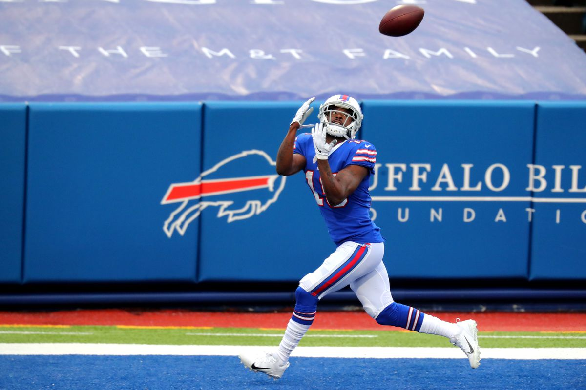 John Brown #15 of the Buffalo Bills catches a touchdown pass from Josh Allen #17 in the second quarter against the Miami Dolphins at Bills Stadium on January 03, 2021 in Orchard Park, New York.