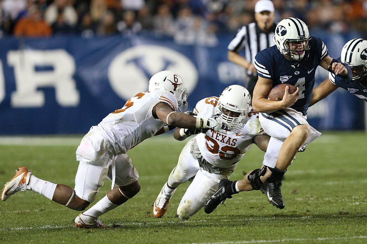 BYU quarterback Taysom Hill breaks tackles vs Texas in Provo