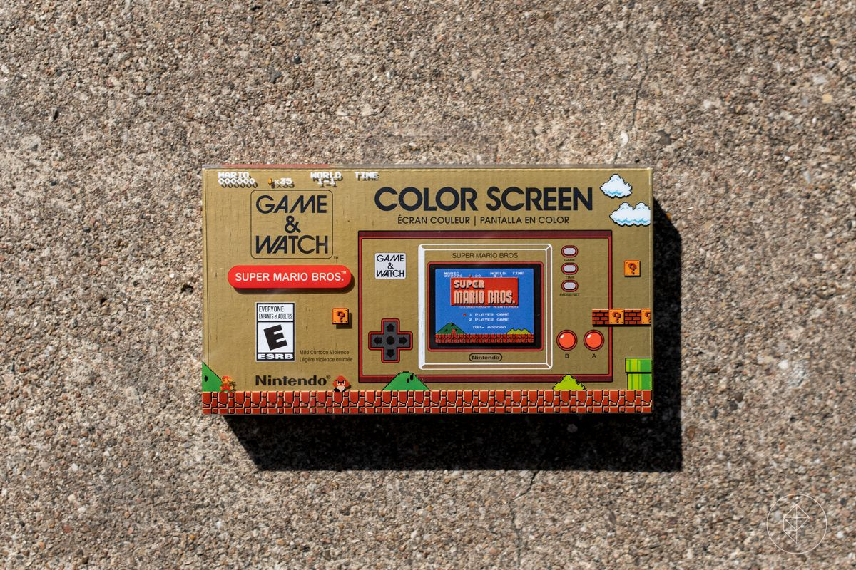 The front of a boxed Nintendo Game & Watch: Super Mario Bros. console photographed on concrete