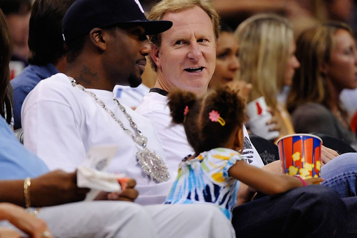 Amare Stoudemire and Robert Sarver chat at the Phoenix Mercury game. Wonder what they are talking about? Photo by Max Simbron. July 1, 2009
