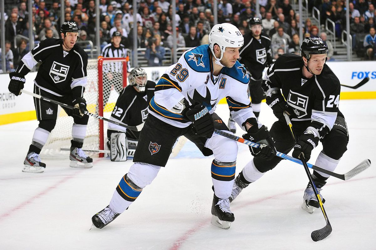 March 20, 2012; Los Angeles, CA, USA; San Jose Sharks left wing Ryane Clowe (29) plays for the puck against Los Angeles Kings center Colin Fraser (24) during the third period at Staples Center. Mandatory Credit: Gary A. Vasquez-US PRESSWIRE