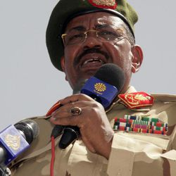 """Sudanese President Omar al-Bashir speaks during a visit to al-Obeid, in North Kordofan, Sudan, Thursday, April 19, 2012. The Arab League said Thursday it would hold an emergency meeting over the increasing violence between Sudan and South Sudan. Sudan President Omar al-Bashir on Wednesday threatened to topple the South Sudan government after accusing the south of trying to take down his Khartoum-based government. Al-Bashir continued his hardline rhetoric on Thursday in an address to a """"popular defense"""" brigade headed to the Heglig area. The ceremony was held in al-Obeid, in northern Kordofan."""