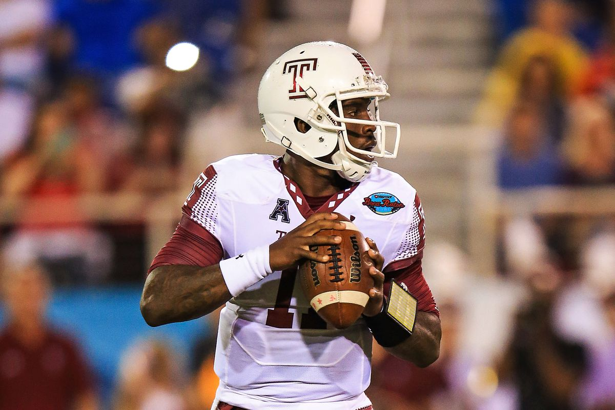 P.J. Walker #11 of the Temple Owls drops back to throw during the first half of the game against the Toledo Rockets at FAU Stadium on December 22, 2015 in Boca Raton, Florida.